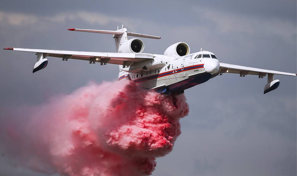 Be-200 multipurpose amphibious aircraft releasing red smoke as it performs a demonstration flight at the 2015 MAKS International Aerospace Show