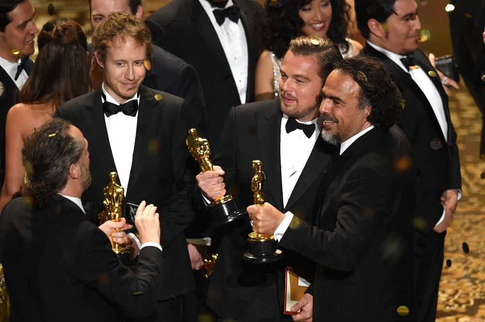 Director Laszlo Nemes, winner of Best Foreign Language Film for 'Son of Saul,' cinematographer Emmanuel Lubezki, Leonardo DiCaprio and Alejandro Gonzalez Inarritu