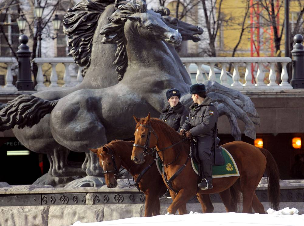 Mounted police officers patrol in Alexandrovsky Garden just outside the Moscow Kremlin, 2006