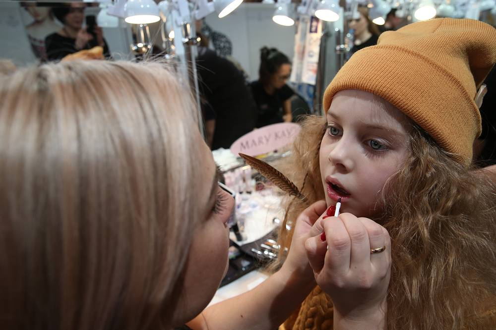 Model backstage preparing to display Children's World collection