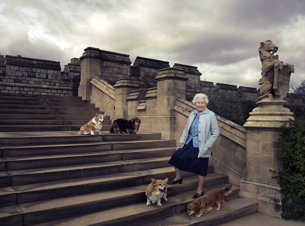 Britain's Queen Elizabeth II seen walking in the private grounds of Windsor Castle, in England, on steps at the rear of the East Terrace and East Garden with four of her dogs: Willow (corgi), Vulcan (dorgie), Candy (dorgie) and Holly (corgi)