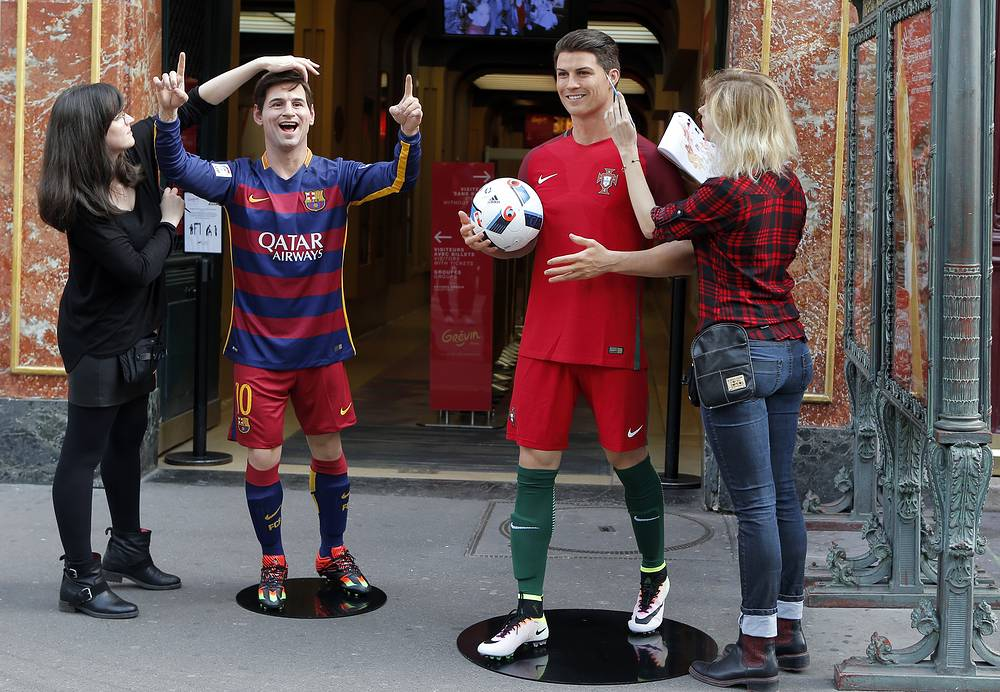 Presentation of the life-size wax figure of Barcelona's Lionel Messi and Real Madrid's Cristiano Ronaldo at Grevin Museum in Paris. The Grevin Museum, founded in 1882, one of the oldest wax museums in Europe, re-opens its bar with video screen to watch the Euro 2016 soccer tournament
