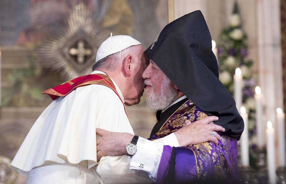 Pope Francis embracing Catholicos Karekin II (R), as he visits the the Apostolic Cathedral of Etkhmiadzin near Yerevan, Armenia