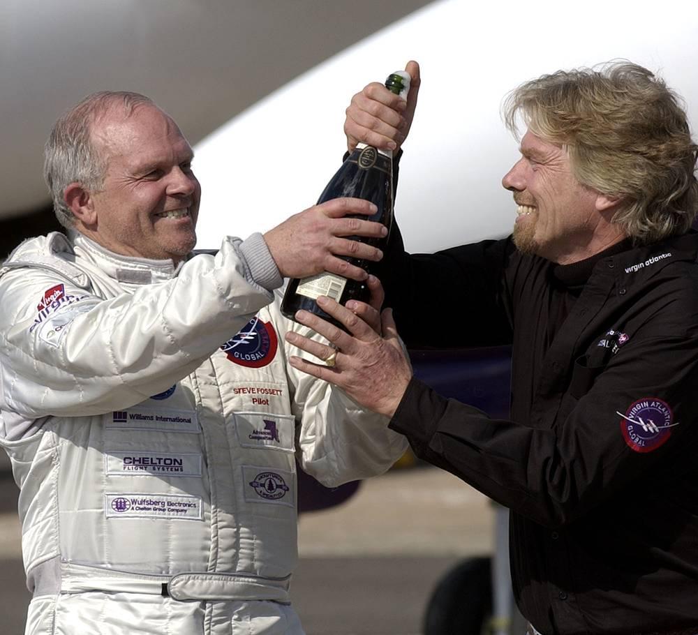 Steve Fossett and Sir Richard Branson celebrating after Fossett landed the GlobalFlyer at the Salina Municipal Airport, USA