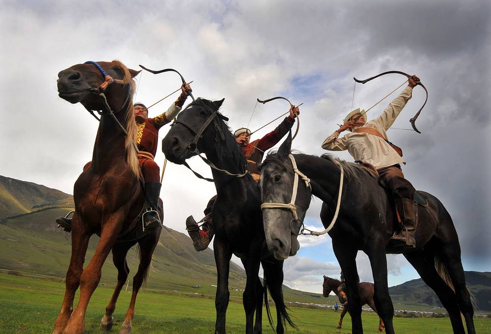 Contestants in traditional costume compete in horseback archery at the 2016 World Nomad Games, Kyrgyzstan, September 5