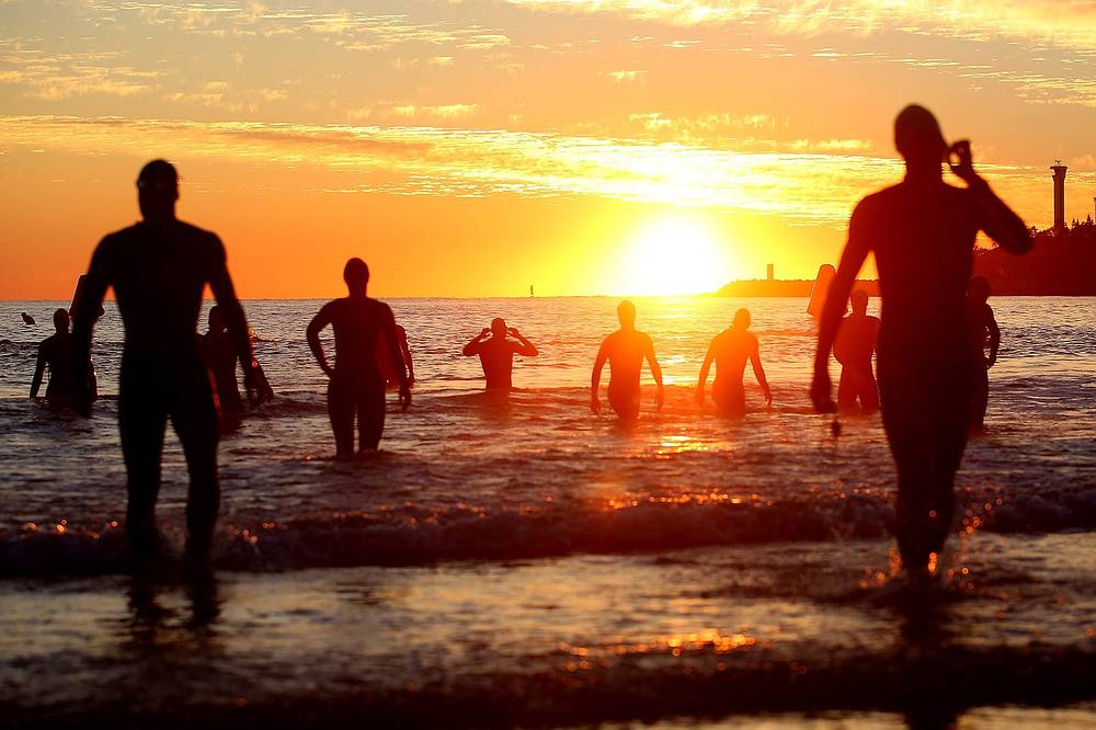 Athletes warm up ahead of the Ironman 70.3 World Championship, Australia, September 4