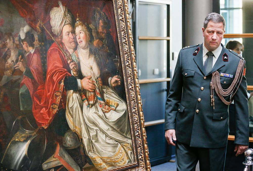 A Dutch officer at the handing ceremony of five paintings to the Dutch Westfries Museum, in Kiev