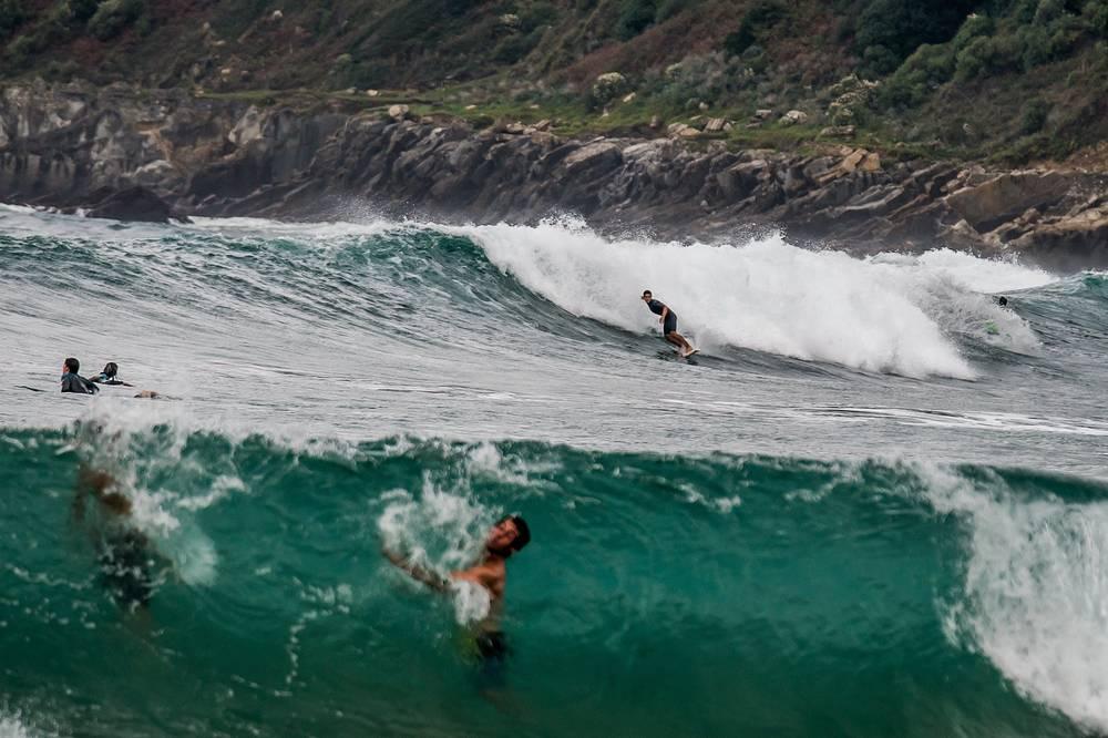 Surfers enjoying a large swell in San Sebastian, Spain, October 4