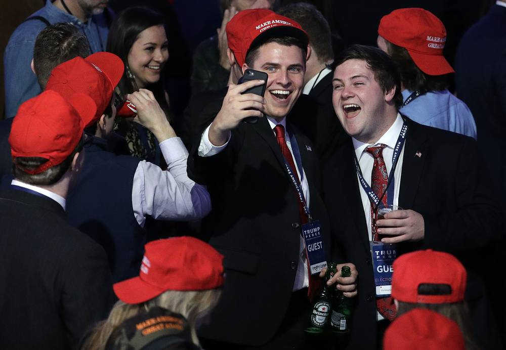 Supporters of Donald Trump take a selfie as they watch the election results in New York