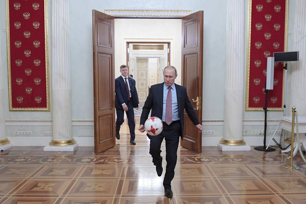 Russia's President Vladimir Putin plays with Krasava, the official match ball for the 2017 FIFA Confederations Cup, Moscow, November 25