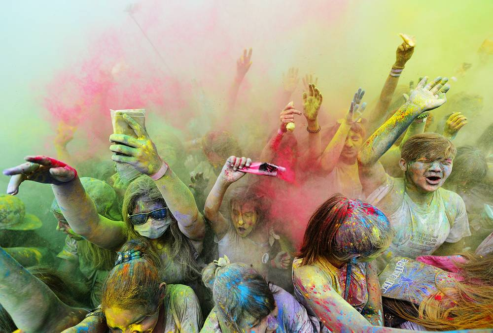 Young people covered in coloured powder during the Holi Festival of Colours, Vladivostok, August 13
