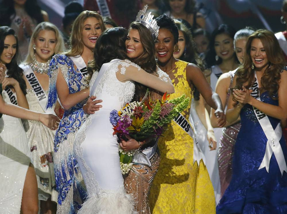 Iris Mittenaere is congratulated by fellow contestants shortly after being proclaimed the Miss Universe