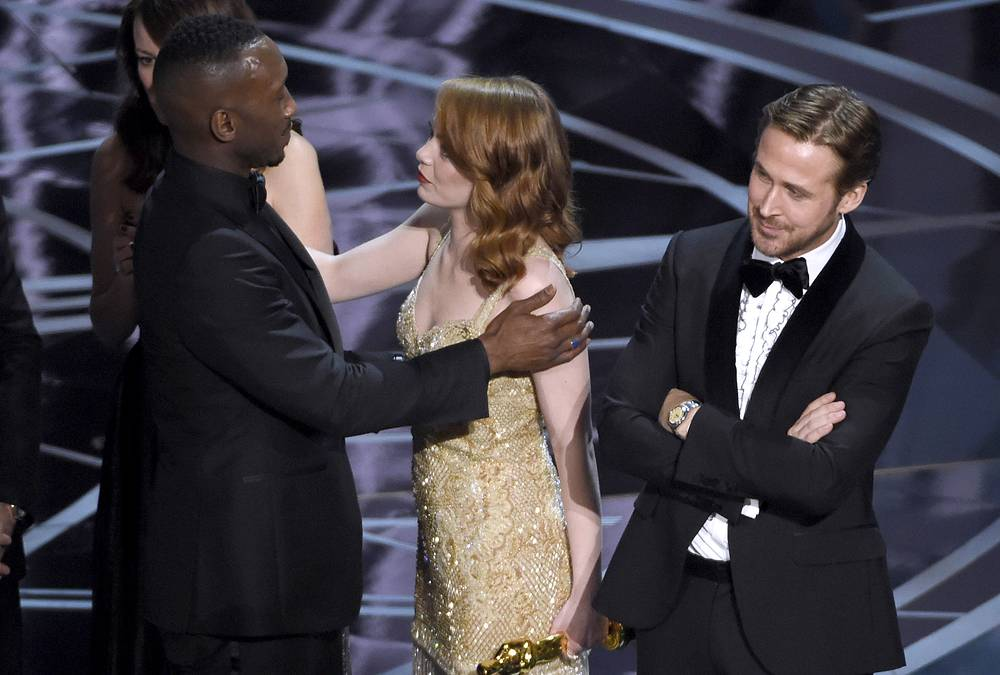"Ryan Gosling reacts as Emma Stone congratulates Mahershala Ali for winning the award for best picture for ""Moonlight"" at the Oscars"