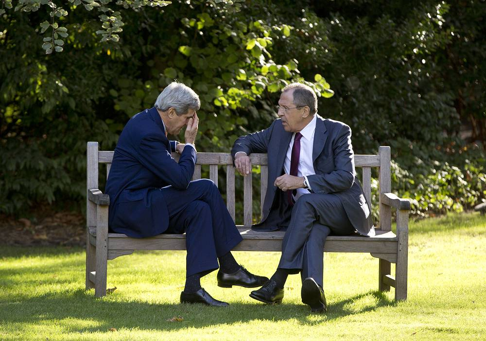 Former US Secretary of State John Kerry and Russian Foreign Minister Sergey Lavrov sit together on the grounds of the Chief of Mission Residence in Paris, France, 2014