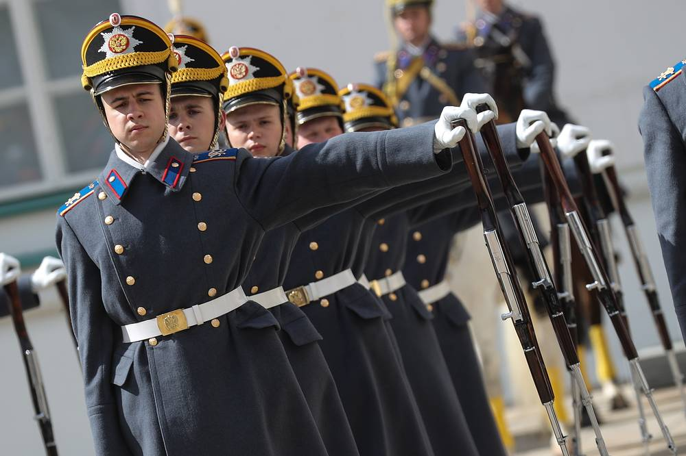 Members of the Presidential Regiment perform at a guard mounting ceremony in the Moscow Kremlin's Cathedral Square