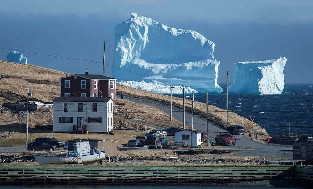 """Residents view the first iceberg of the season as it passes the South Shore, also known as """"Iceberg Alley"""", near Ferryland Newfoundland, Canada, April 16"""