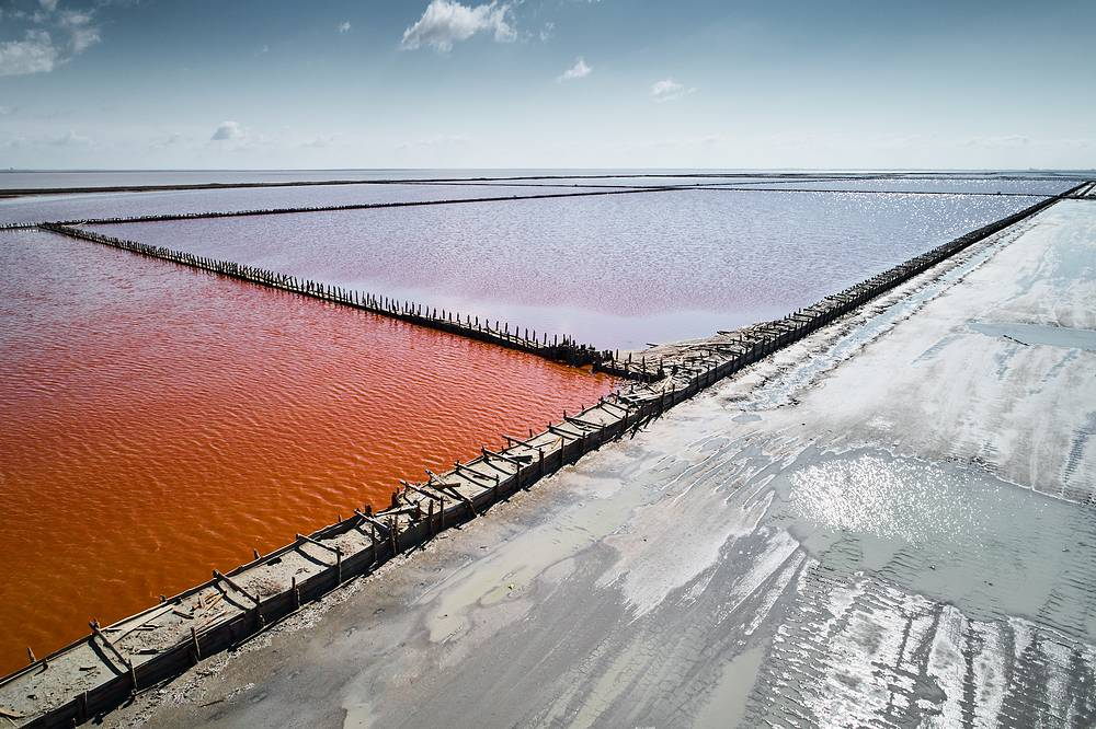 Pink salt production at the biggest salty lake In Crimea Sasyk-Sivash, April 27