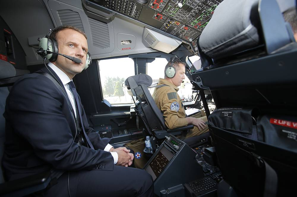 French President Emmanuel Macron seats in the cockpit of an Airbus A400M turboprop transport plane