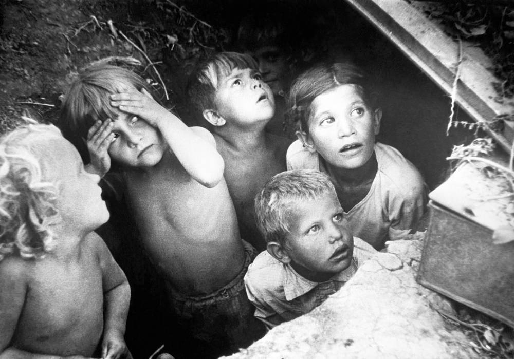 Children hide in an air raid shelter during Nazi German attacks on the Eastern Front, 1941