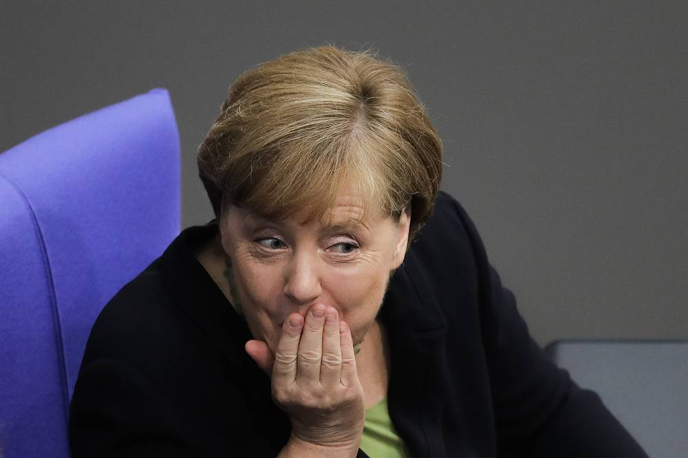German Chancellor Angela Merkel talks with Vice Chancellor and Foreign Minister Sigmar Gabriel, at the Reichstag building in Berlin, Germany, June 22