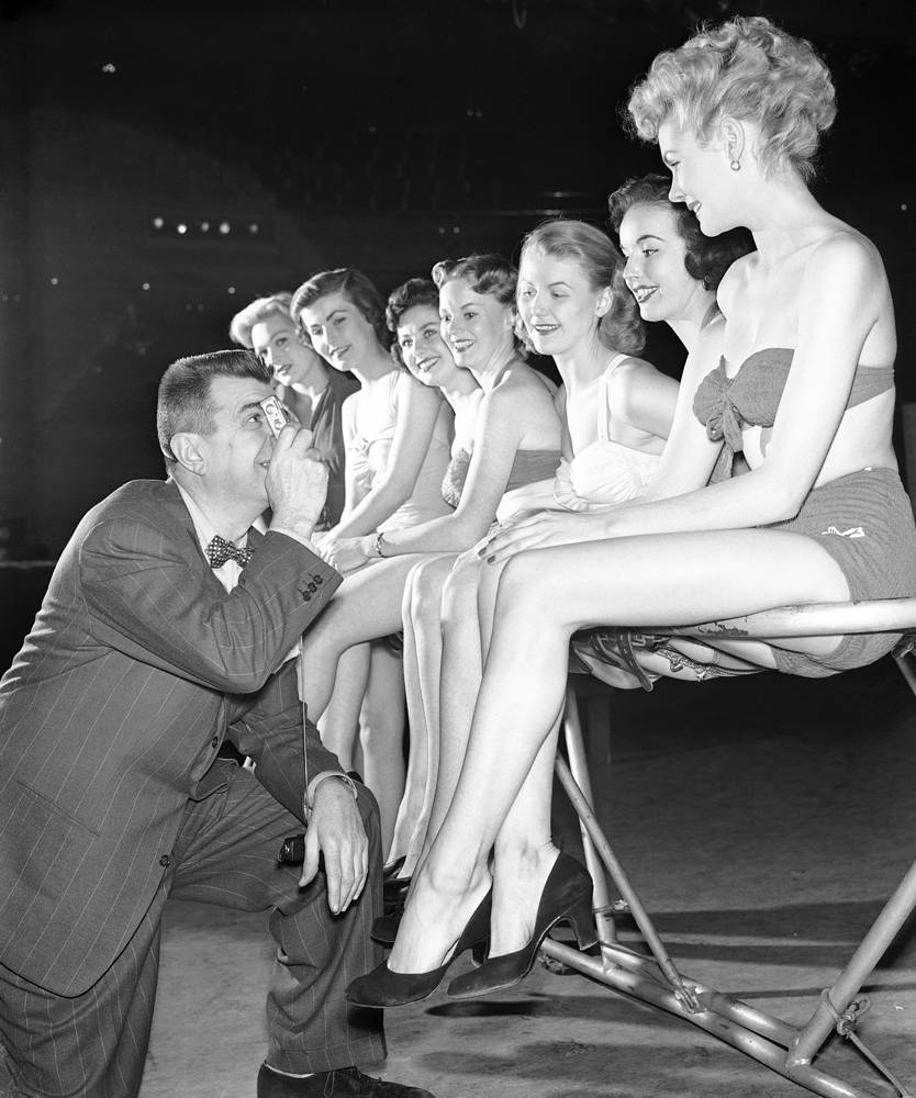 Comedian Ken Murray selecting young women for his television program at CBS studio in New York, 1952