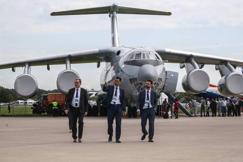 Visitors walk by an Ilyushin Il-76MD-90A strategic airlifter