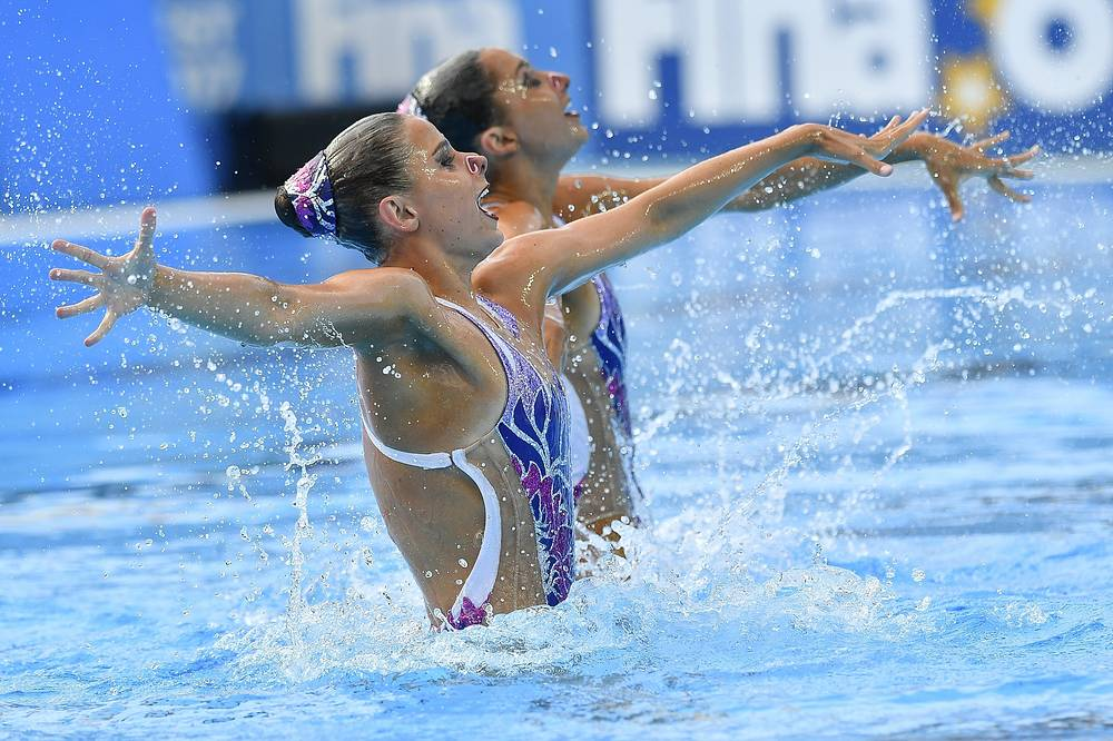 Anita Alvarez and Victoria Woroniecki of the US perform in women's synchronized swimming duet preliminary technical routine competition