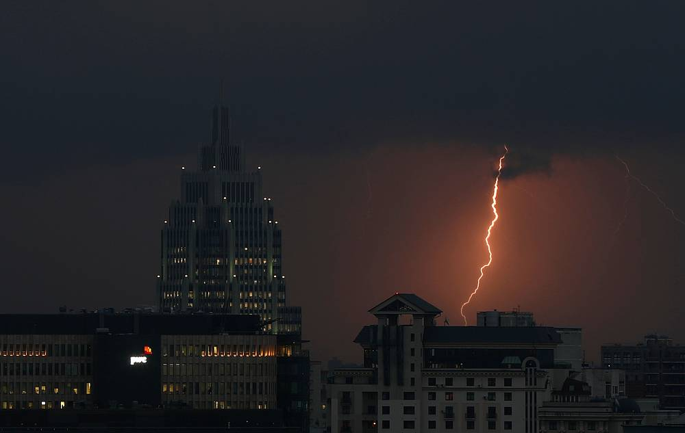 A streak of lightning is seen above office buildings in Moscow, Russia, August 14