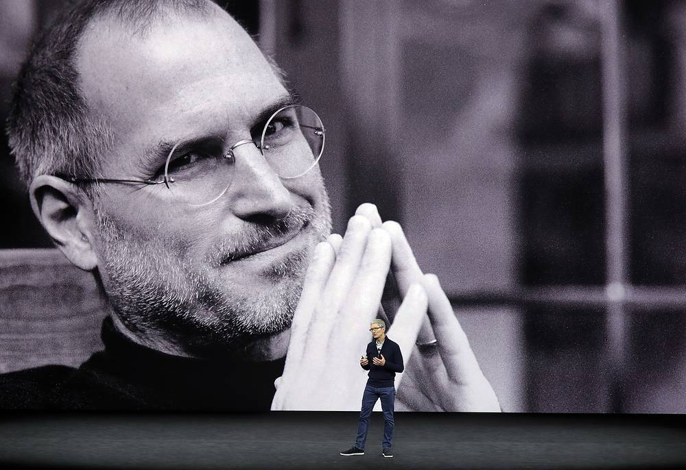 Apple said the iPhone X uses a new face ID authentication, using a state-of-the-art TrueDepth camera system made up of a dot projector, infrared camera and flood illuminator, and is powered by A11 Bionic to accurately map and recognize a face. Photo: With a photo of former Apple co-founder and CEO Steve Jobs projected in the background, Apple CEO Tim Cook kicks off the event at the Steve Jobs Theater on the new Apple campus