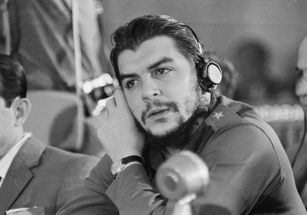 Cuba's Ernesto Che Guevara listening to the speech of the Brazilian delegate, at the Inter-American Economic and Social Conference at Punta del Este, 1961