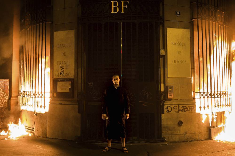 Russian Pyro performer Pyotr Pavlensky poses in front of Banque de France's building after setting fire to the window gates as part of a performance in Paris, France, October 16