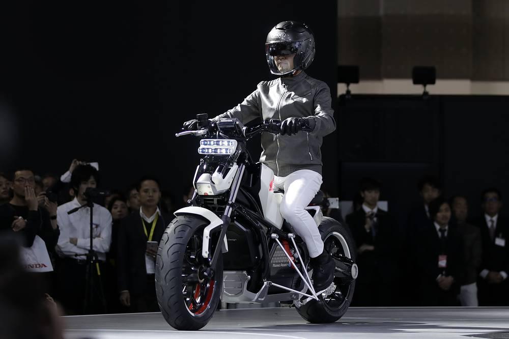 A model demonstrates Honda Motor Co.'s Honda Riding Assist-e