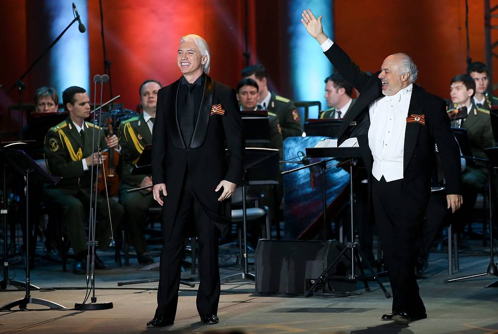 "Russian baritone Dmitri Hvorostovsky and US conductor Constantine Orbelian perform with the Song and Dance Ensemble of the Russian Interior Ministry in a concert titled ""Songs of the War Years"" at the Green Theatre of the VDNKh Exhibition Centre, 2016"