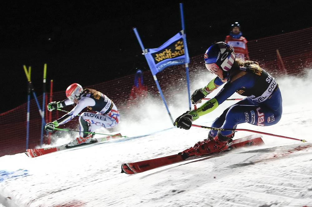 United States' Mikaela Shiffrin and Slovakia's Petra Vlhova compete during the final run of an alpine ski, women's World Cup parallel slalom in Courchevel, France, December 20