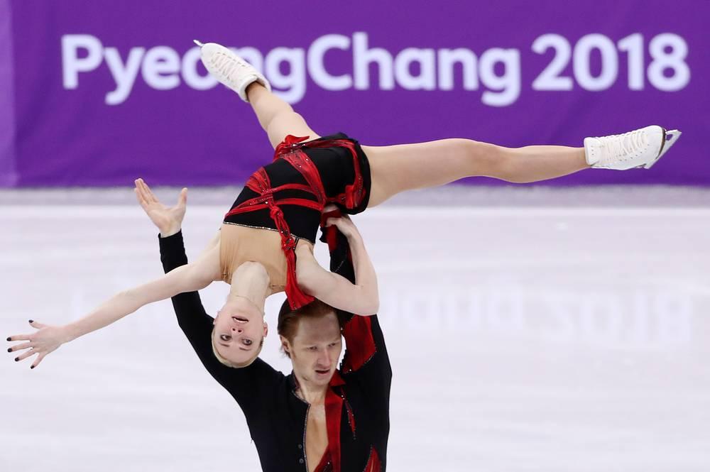 Yevgenia Tarasova and Vladimir Morozov perform in the pair skating short program team event
