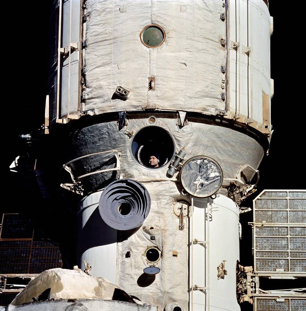 On June 29, 1995, STS-71 became the first Shuttle mission ever to dock with the station. Photo: Cosmonaut Valeriy Polyako looks out Mir's window during rendezvous operations with the Space Shuttle Discovery, 1995