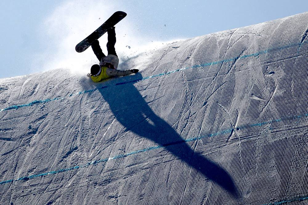 Snowboarder Sina Candrian of Switzerland competes in women's snowboarding slopestyle finals