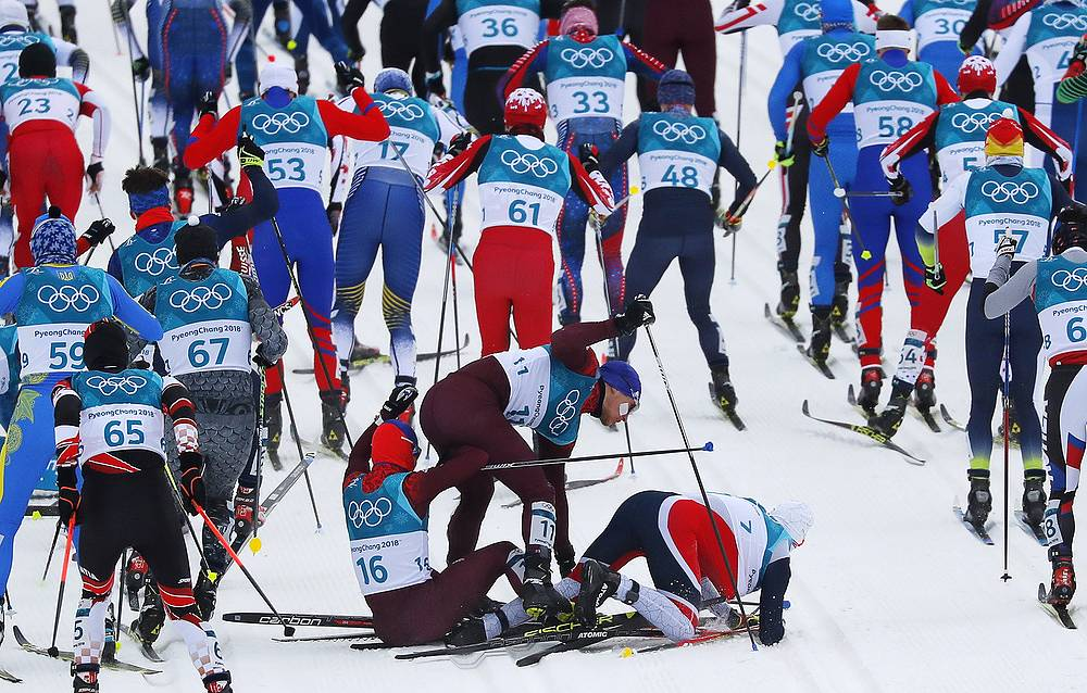 Denis Spitsov, Andrey Larkov, Olympic athletes from Russia and Simen Hegstad Krueger of Norway crash during men's 15km+15km skiathlon cross-country skiing final