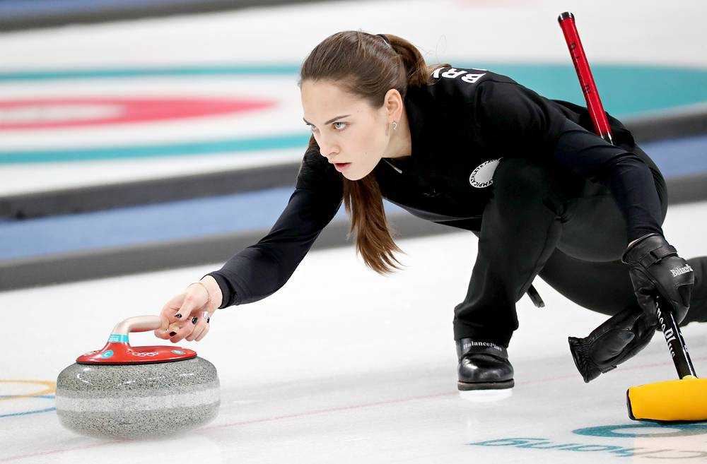 Anastasia Bryzgalova from Russia delivers a stone during the Mixed Doubles Round Robin semi final match at the Gangneung Curling Centre