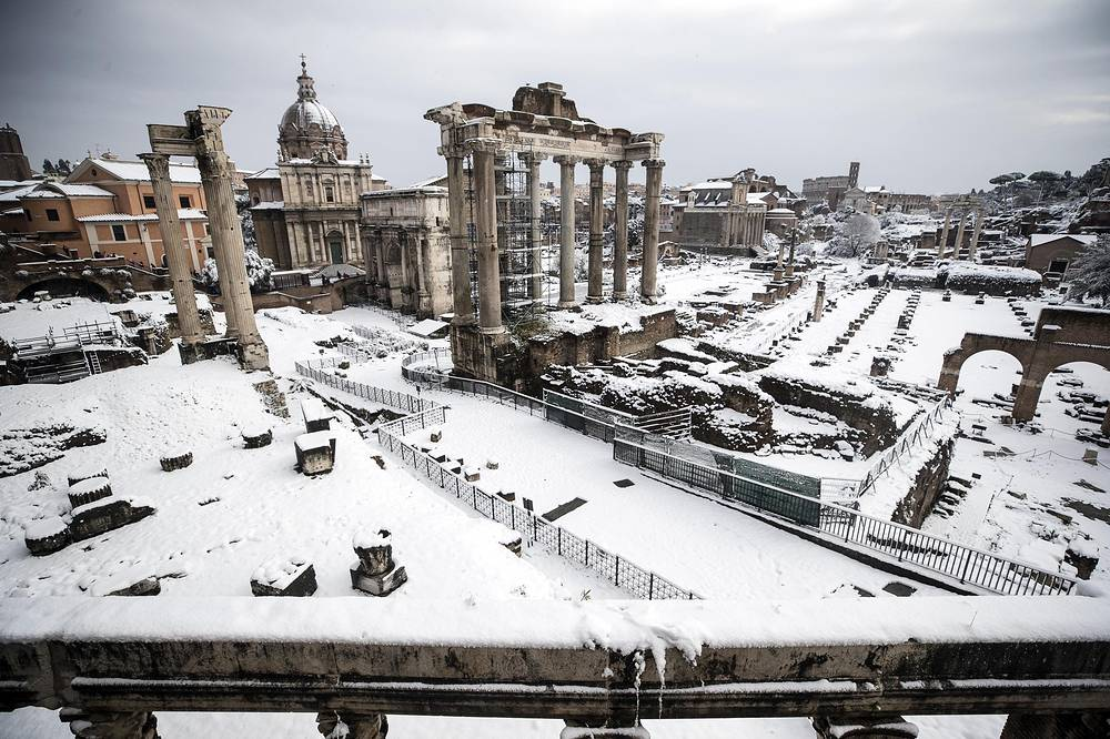 The Fori Imperiali is covered by snow during a snowfall in Rome, Italy