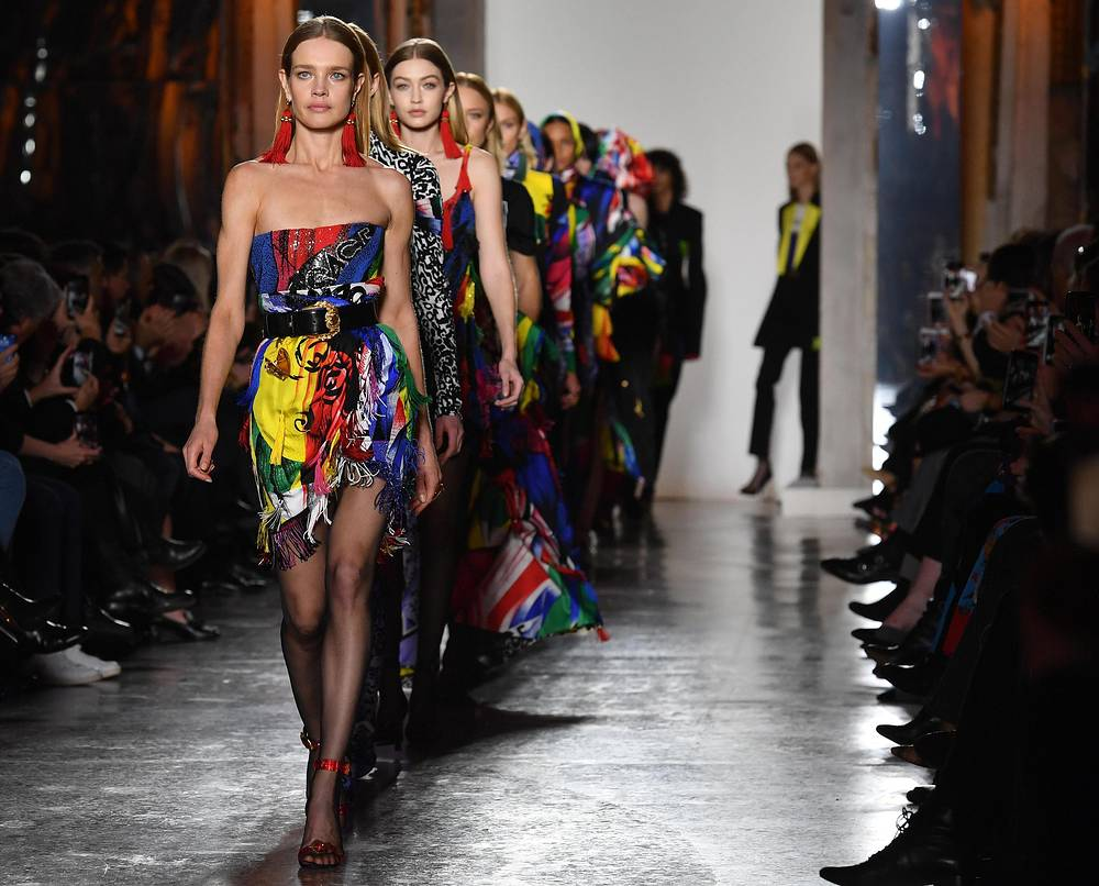 She is well known for her Cinderella-like life story. Photo: Natalia Vodianova and Gigi Hadid wear creations by Versace during the Milan Fashion Week