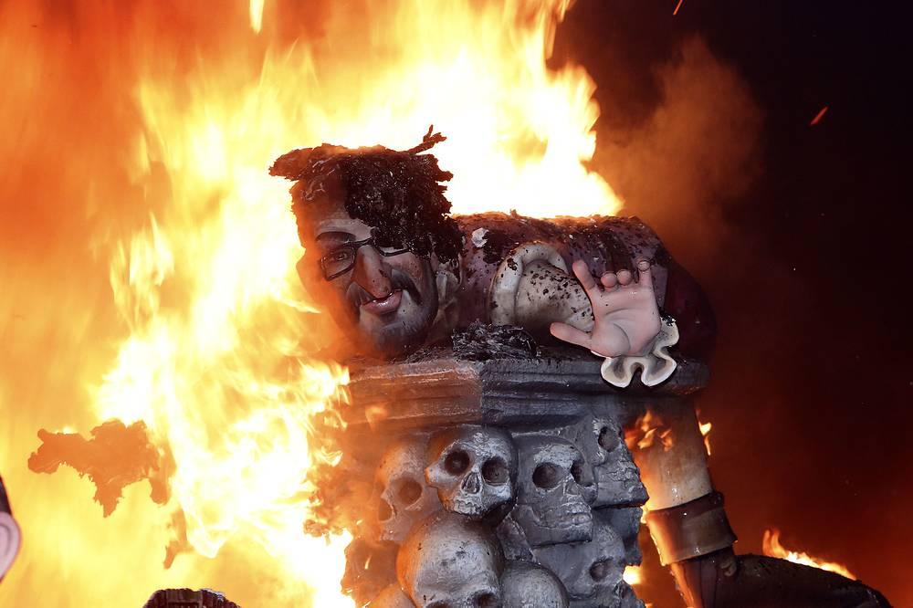 "Every year the city of Valencia celebrates the ancient ""Las Fallas"" fiesta, a noisy week that is full of fireworks and processions, burning many characters and large papier mache satirical figures displayed around the streets of the city"