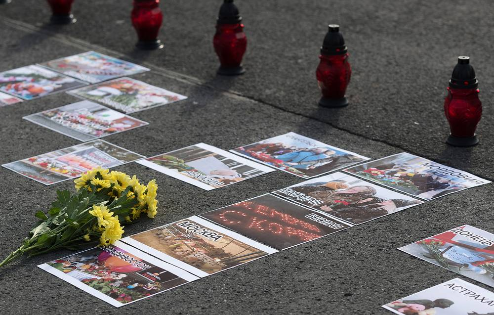Flowers seen during a memorial event on the day of mourning for the shopping mall fire victims in Kemerovo