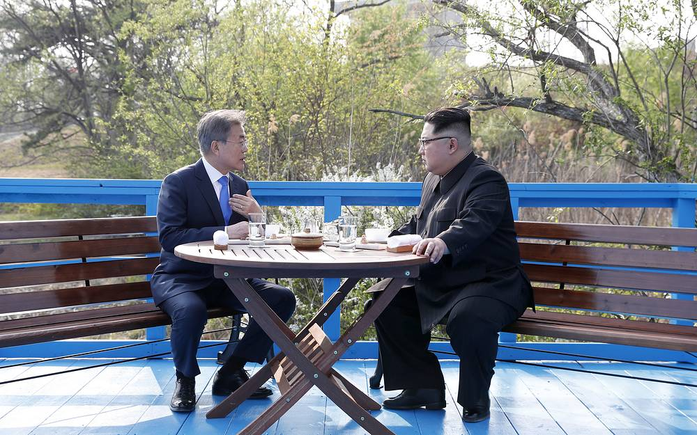 North Korean leader Kim Jong Un and South Korean President Moon Jae-in talk at the border village of Panmunjom in the Demilitarized Zone, South Korea
