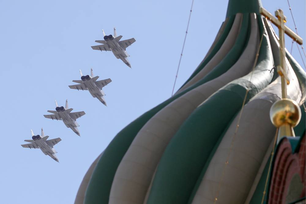 Mikoyan MiG-31K fighter jets with Kinzhal hypersonic missiles fly over Moscow's Red Square