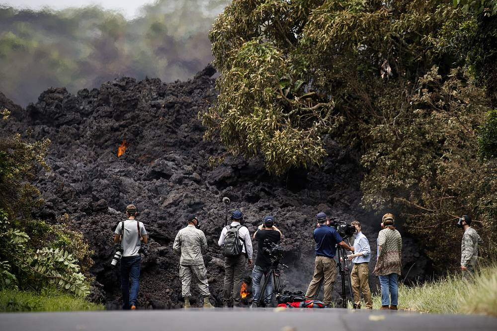 Kilauea volcano eruption shot up plumes of steam from its summit that led officials to distribute face masks to protect against ash particles