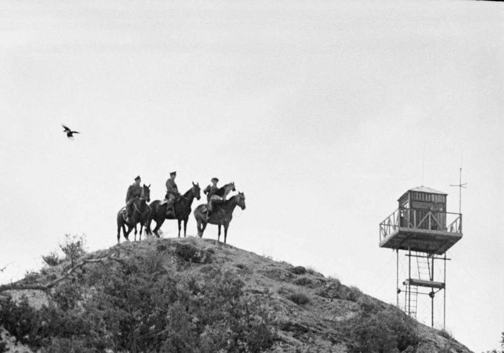 Border guards on horseback inspect the border, 1970
