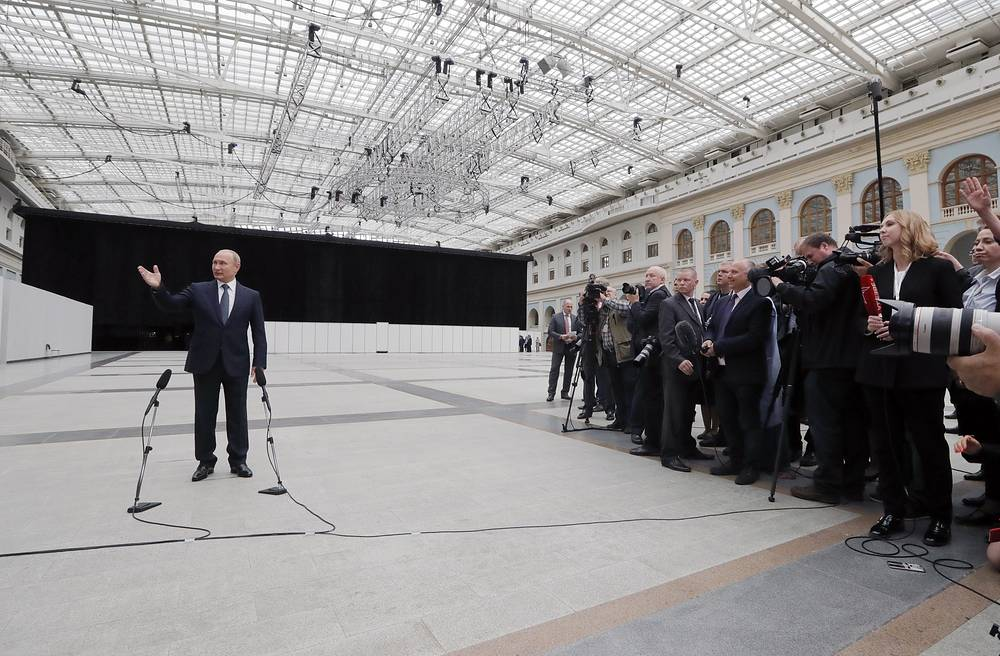 Russia's President Vladimir Putin talks to the media