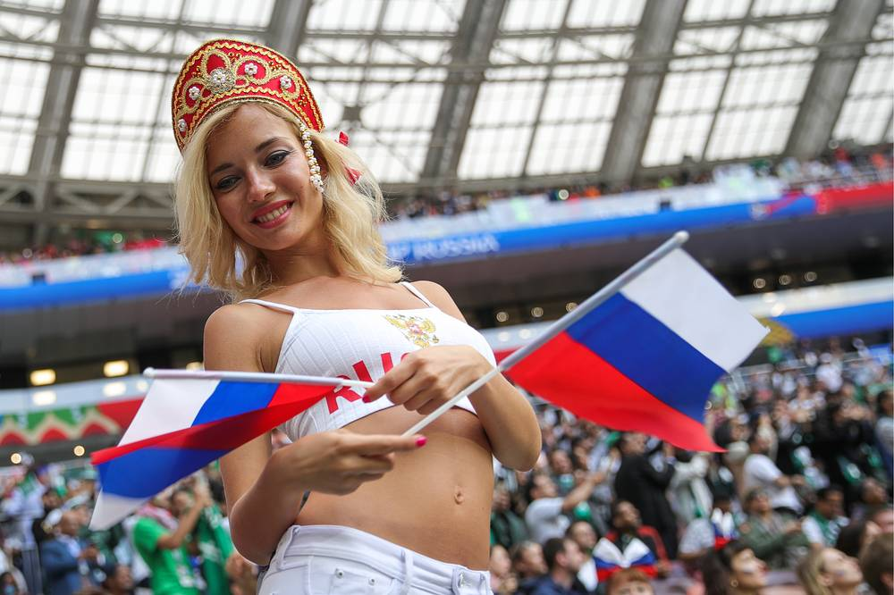 Russia's fans cheer ahead of the 2018 FIFA World Cup opening match against Saudi Arabia at Luzhniki Stadium