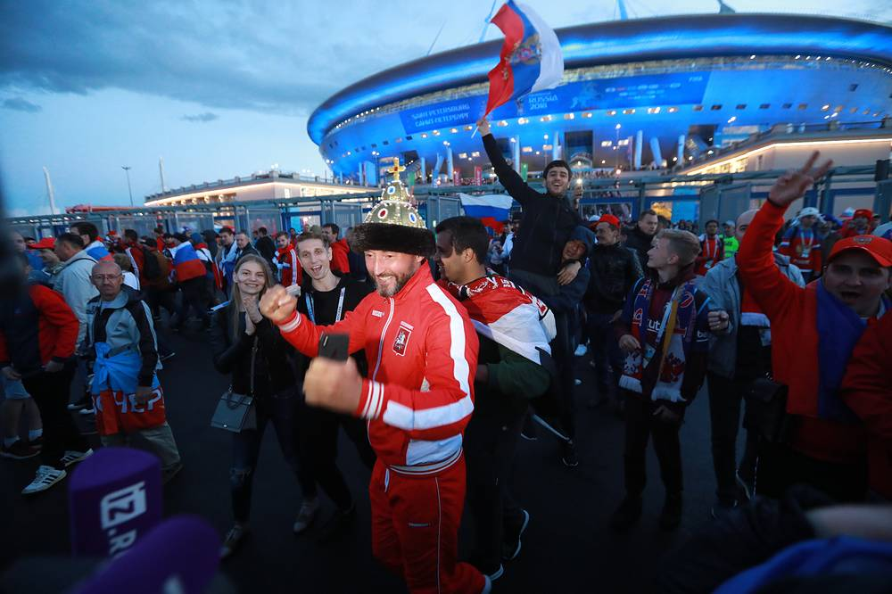 Russian football fans celebrate their team winning outside Saint Petersburg Stadium